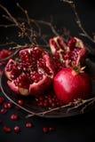 Pomegranate. Burgundy garnet. Grains juicy. Pomegranate. source of iron Stock Photo