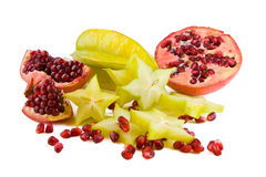 Pomegranate and carambola Stock Images