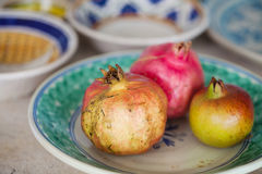 Pomegranate on  ceramic plate. Pomegranate from garden on  ceramic plate Stock Photo
