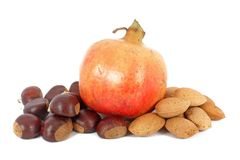 Pomegranate, chestnuts and almonds Royalty Free Stock Photo