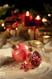 Pomegranate on a christmas, new year's eve table Stock Photography