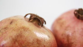 Pomegranate. Close up two pomegranate on white background stock footage