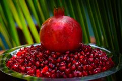 Pomegranate and its seeds closeup, background royalty free stock image