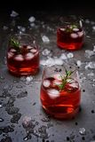 Pomegranate cocktail on the black concrete background. royalty free stock image