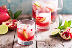 Pomegranate cocktail with lime slices Royalty Free Stock Image