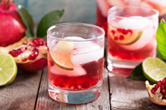 Pomegranate cocktail with lime slices Royalty Free Stock Photography