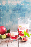 Pomegranate cocktail with lime slices Stock Photo