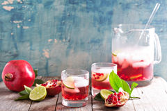 Pomegranate cocktail with lime slices Stock Photography