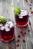 Pomegranate cocktail with pomegranate seeds, lime and mint. alcoholic and non-alcoholic Royalty Free Stock Image