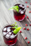Pomegranate cocktail with pomegranate seeds, lime and mint. alcoholic and non-alcoholic Royalty Free Stock Photos