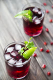 Pomegranate cocktail with pomegranate seeds, lime and mint. alcoholic and non-alcoholic Royalty Free Stock Photography