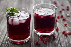 Pomegranate cocktail with pomegranate seeds, lime and mint. alcoholic and non-alcoholic Stock Image