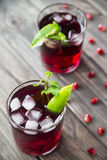 Pomegranate cocktail with pomegranate seeds, lime and mint. alcoholic and non-alcoholic Stock Photo