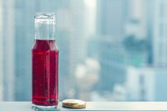 Pomegranate cold juice in bottles opposite the metropolis. And skyscrapers Stock Image
