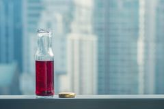 Pomegranate cold juice in bottles opposite the metropolis. And skyscrapers Royalty Free Stock Images