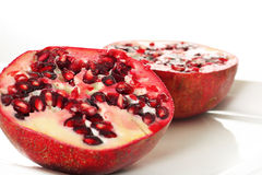 Pomegranate cut in half. Shot of a pomegranate cut in half Stock Image