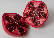 Pomegranate cut in half Royalty Free Stock Image