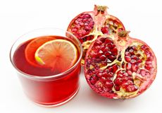 A pomegranate cut and a juice Royalty Free Stock Image
