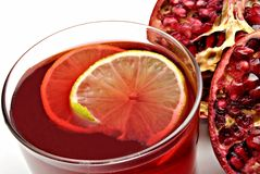 A pomegranate cut and a juice Stock Photography
