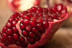 Pomegranate. Cut on wooden background stock image