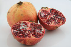 Pomegranate cuted. On white background Stock Image