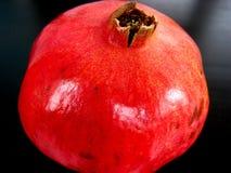 Pomegranate on dark background. Bright red pomegranate on dark background Stock Photography