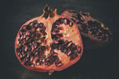 Pomegranate on dark background. Delicious pomegranate on dark background Royalty Free Stock Image