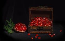 Pomegranate on a dark background stock photo