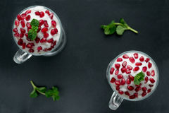Pomegranate dessert. With cream and mint Royalty Free Stock Photos