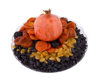 Pomegranate, dried apricots, prunes and raisin. Pomegranate, dried apricots, prunes, raisin, fruit and berries Stock Image