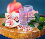 Pomegranate drink from the garnet grains, selective focus Stock Photos