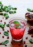 Pomegranate drink with mint and ice stock photography