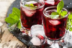 Pomegranate drink with mint and ice, selective focus stock images