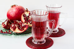 Pomegranate drink and pomegranate. Stock Photography