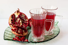 Pomegranate drink and pomegranate. Stock Images