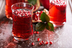 Pomegranate drink with sparkling water. Fall cold beverage Royalty Free Stock Photo