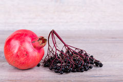 Pomegranate with elder berry Stock Photo