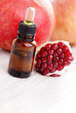 Pomegranate essential oil Royalty Free Stock Images