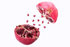 Pomegranate in flight burst on a white background, isolated. Cut half pomegranate flying in the air. Pomegranate fruit. Explosion royalty free stock photography