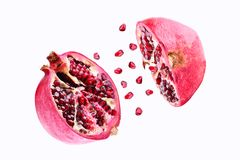 Pomegranate in flight burst on a white background, isolated. Cut half pomegranate flying in the air. Pomegranate fruit. Explosion royalty free stock images