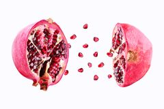 Pomegranate in flight burst on a white background, isolated. Cut half pomegranate flying in the air. Pomegranate fruit. Explosion royalty free stock image