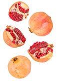 Pomegranate flying isolated on white background with clipping path. Creative fruit concept. pomegranates flying in the air isolated on white with clipping path royalty free stock photos