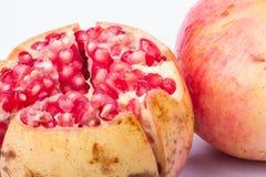 Pomegranate fruit. On a white background royalty free stock photo