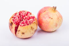 Pomegranate fruit. On a white background royalty free stock photos
