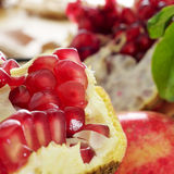 Pomegranate fruit. Closeup of an open pomegranate fruit, with its red edible seeds stock images