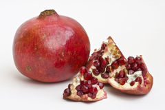 Pomegranate fruit. And segments showing seeds royalty free stock photos