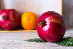 Pomegranate on the fruit background. Pomegranate fruit on a background of fruit in a box Royalty Free Stock Photography