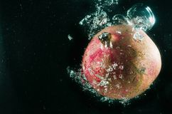 Pomegranate. Fruit with drops isolated on black. With bubbles Stock Photography