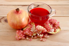 Pomegranate. Fruit is eaten as a sweet or sour and sweet  is a fruit that have health benefits.  juice high in vitamin C stock photos