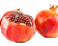 Pomegranate Fruit Expose Seeds III. Pomegranate fruits with expose seeds over white background Royalty Free Stock Photo